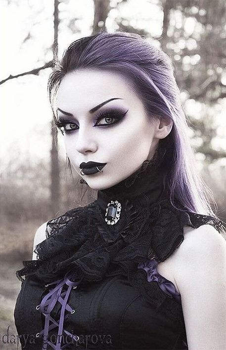 b89701fa9663 Great example of gothic makeup and the lace around the neck with the brooch  with a good idea.