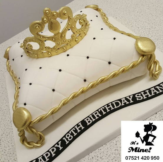 White, Black And Gold Quilted Cake With A Crown By It's