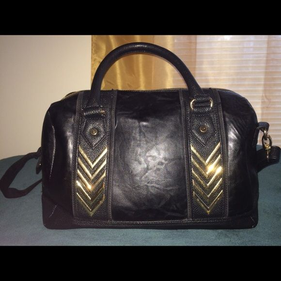 Dope black Aldo Bag When edgy meets sexy you get this bag. This purse will get so many compliments. Wear everyday or with a combat look!! ALDO Bags Satchels