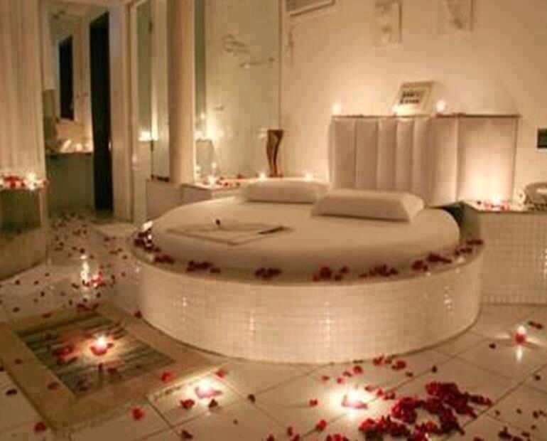 Romantic Beds rose petals all around bedroom, round bed, mirrors and candles set