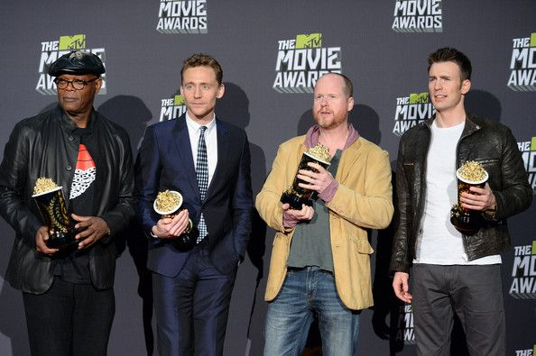 """Chris Evans Photos Photos - (L-R) Actors Samuel L. Jackson and Tom Hiddleston, director Joss Whedon, and actor Chris Evans, winners of Movie of the Year for """"Marvel's The Avengers,"""" pose in the press room during the 2013 MTV Movie Awards at Sony Pictures Studios on April 14, 2013 in Culver City, California. - MTV Movie Awards Press Room"""
