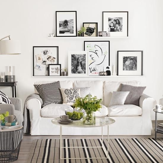 White living room with a gallery wall Try a staggered arrangement to show off an assortment of artwork and family photographs using a couple of narrow picture ledges. This works well if you have lots of pictures in different shapes and sizes. Read more at http://www.housetohome.co.uk/room-idea/picture/10-best-white-living-room-ideas#Rs644tJEGWiOkmjt.99