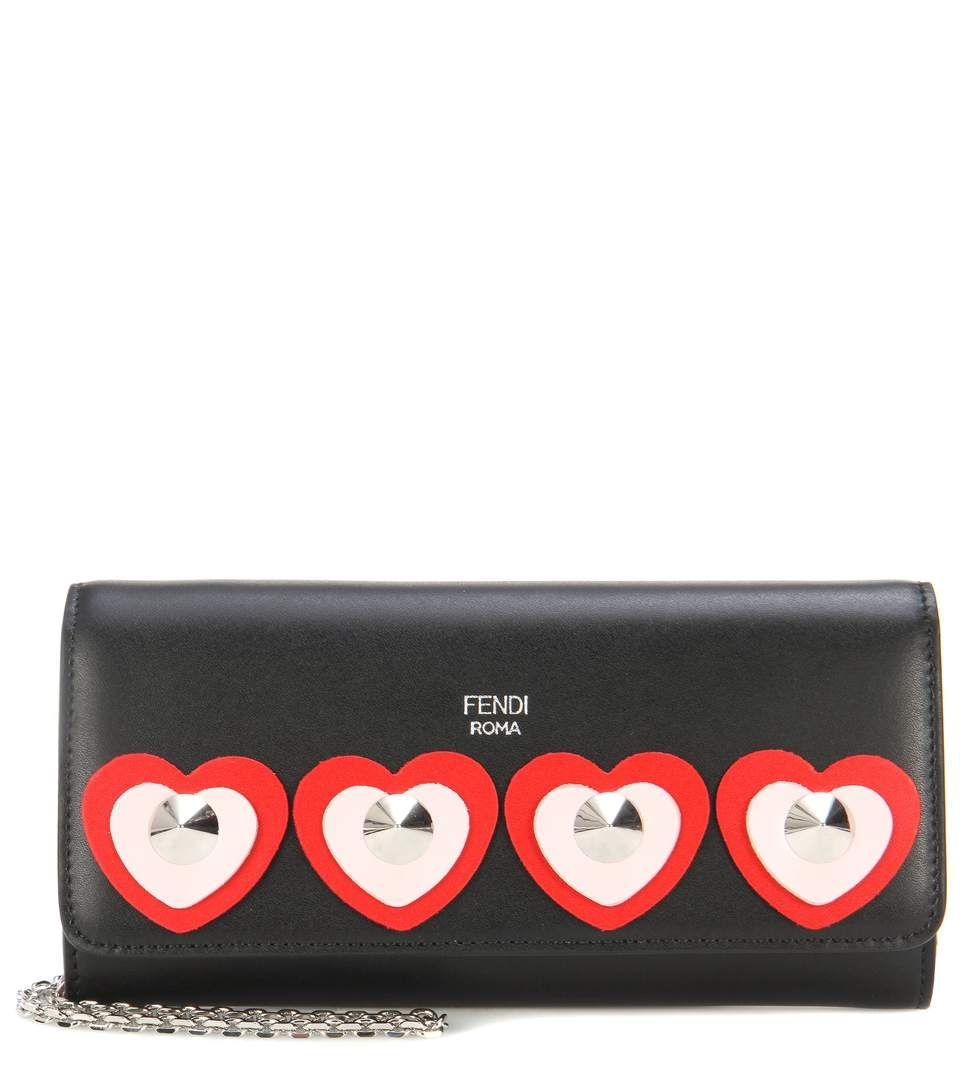 FENDI - Leather wallet on chain - Fendi's leather wallet comes with a delicate jewellery-inspired chain to double as a mini bag. Crafted in Italy from smooth black leather, this style is embellished with playful hearts and shiny silver-tone studs. The inside features card slots and a zipped pouch for easy organisation. Let yours bring whimsical appeal to daytime looks. - @ www.mytheresa,com