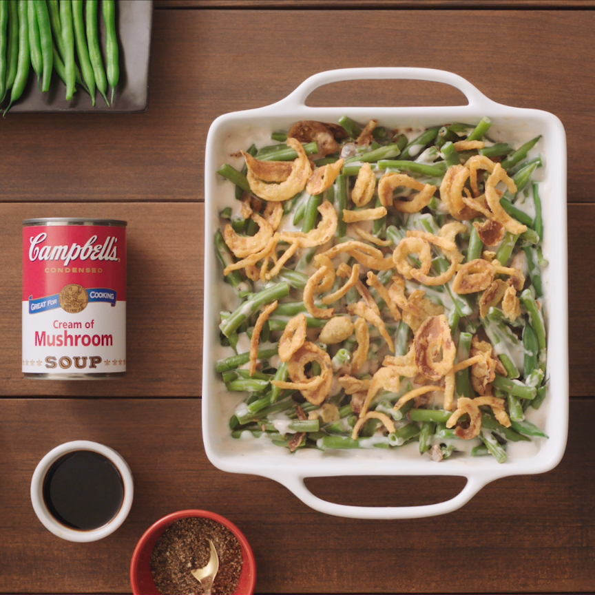 It is the dish everyone is expecting on the holidays, but it is so easy to make, you can serve it any day. Created by Campbell Test Kitchen Manager Dorcas Reilly in 1955, its creamy, smooth sauce and unmatchable flavor combined with its simplicity makes Green Bean Casserole so appealing. Just six ingredients and 10 minutes to put together, this family pleasing side has been a favorite for over 60 years. Looking to try a new spin on the traditional? Then try: Bacon & Cheddar Green Bean Casserole. #greenbeancasserole