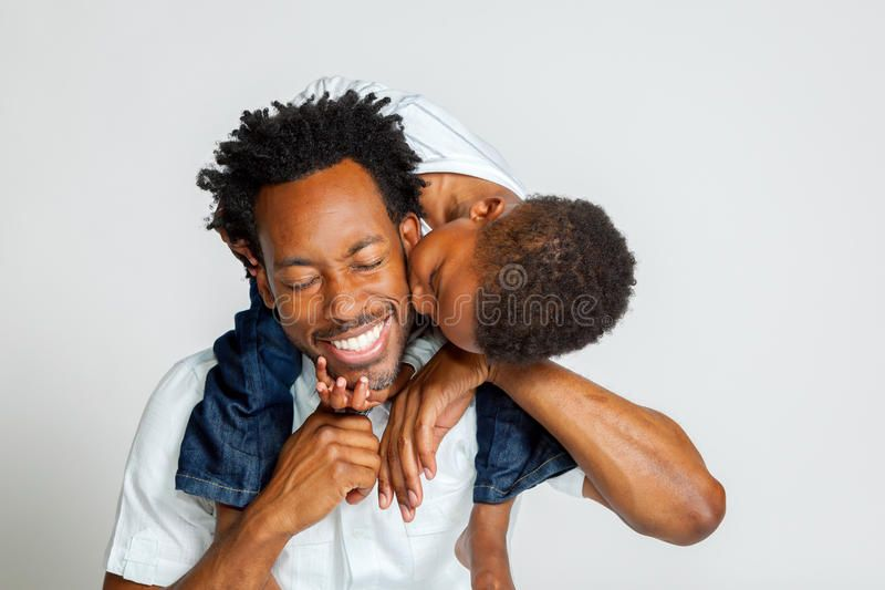 African American Boy Kisses Father An African American Boy On The
