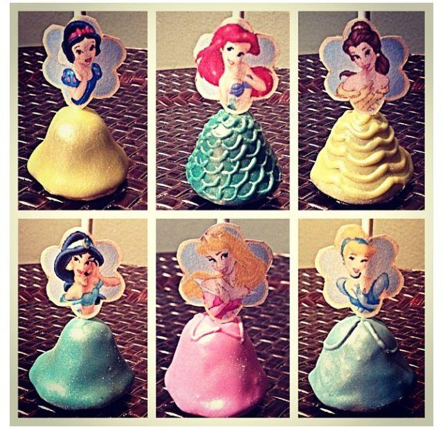 Princess cake pops, but do cupcakes instead using mini princess dolls