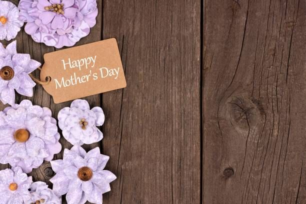 happy mothers day gift tag with flower side border over wood