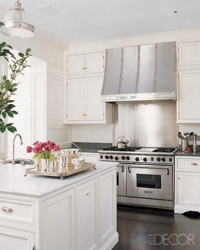 classic kitchen.  stainless hood + marble + walnut + white