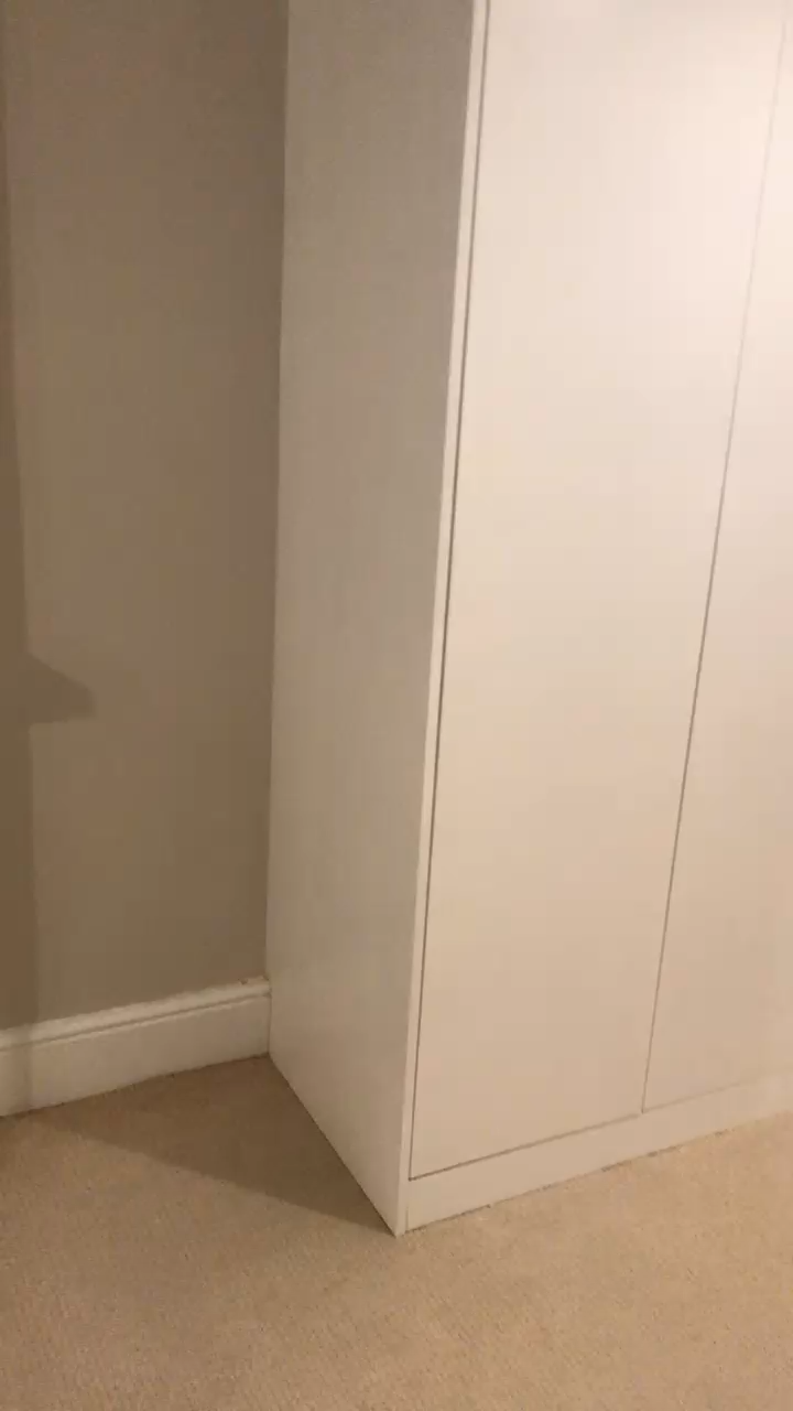 L shaped fitted wardrobe in London