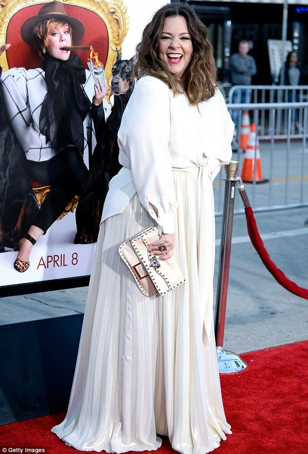 Owning the carpet: Melissa McCarthy, 45,  commanded attention in a cream ensemble while at the premiere of her film, The Boss, in LA on Monday