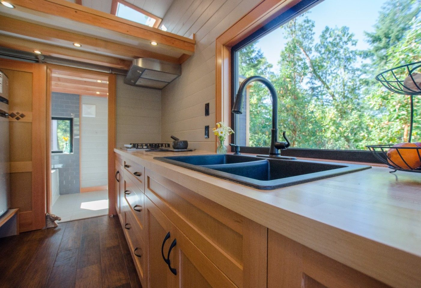 Kestrel tiny house: Soak in the tub and drink in the view #tinyhousebathroom