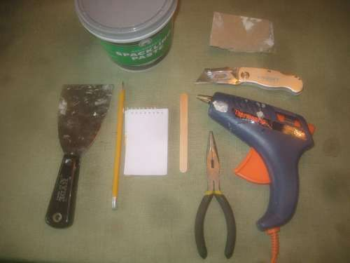 A Trick For Patching Drywall Using Hot Glue With Images How To Patch Drywall Hot Glue