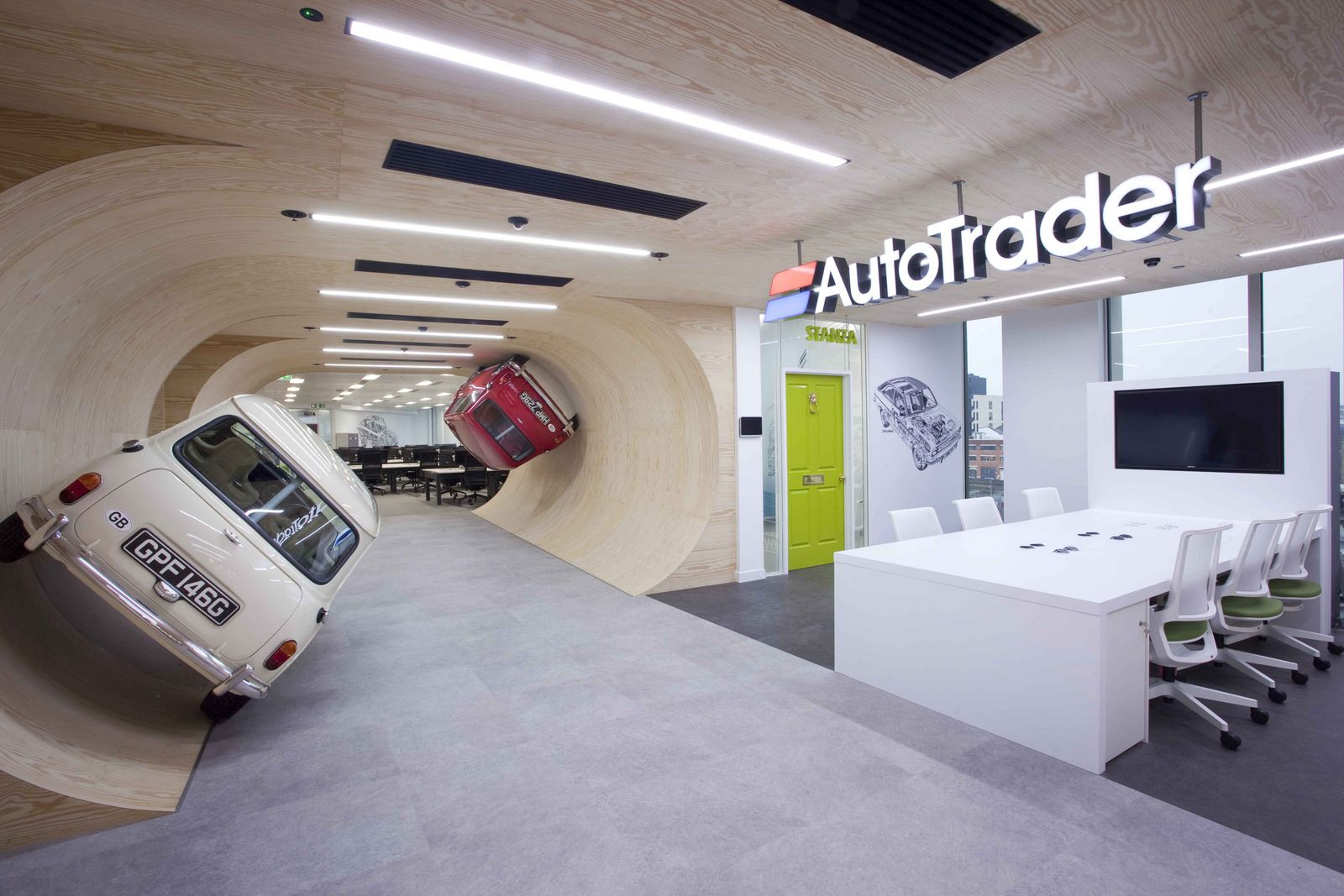 With fullsize Mini Coopers on the wall AutoTraders London HQ