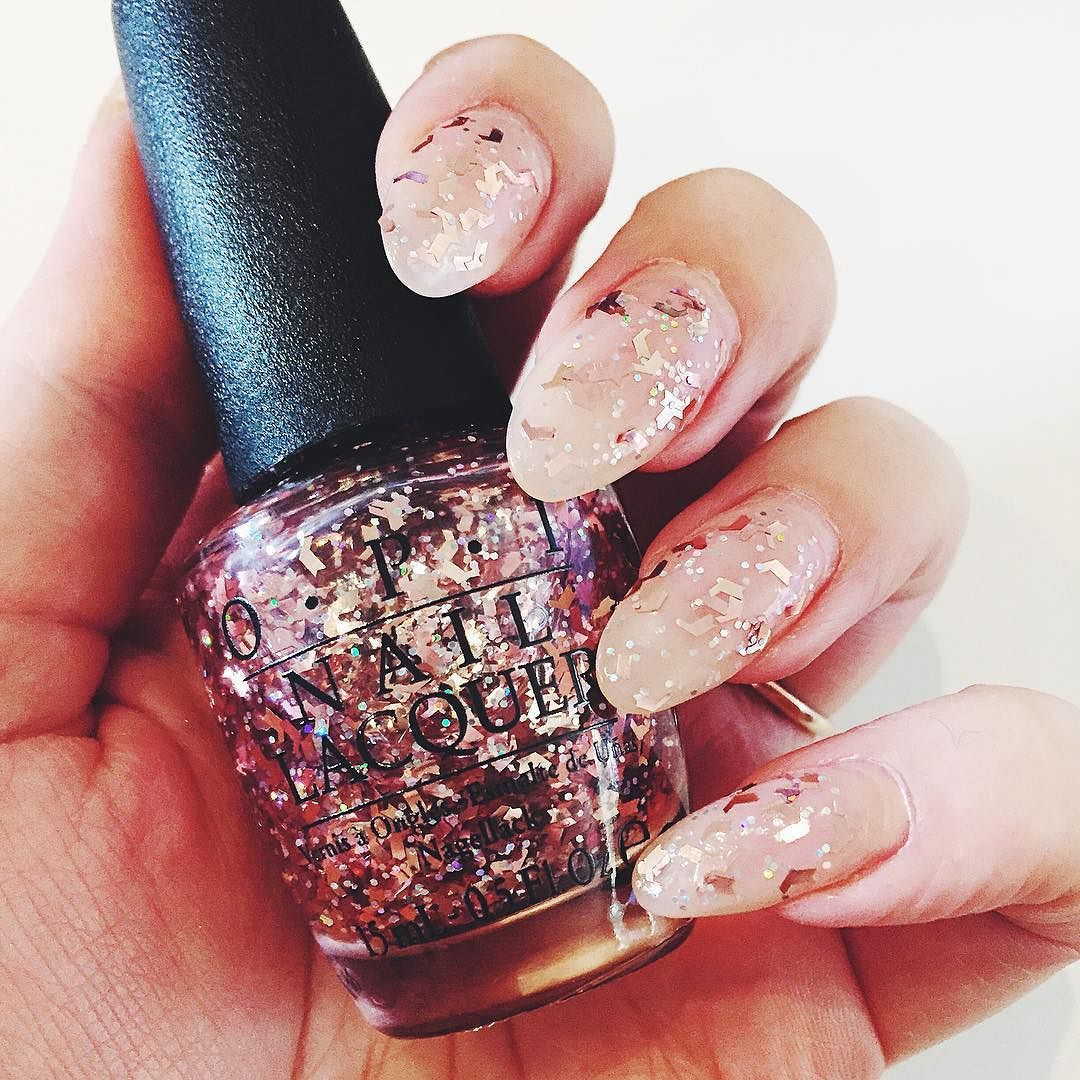 """Christmas nails picked! """"Infrared-y to Glow"""" from @opiaustralia's Starlight holiday collection is the perfect way to glitz up a nude nail for the festive season  by thedailymark"""