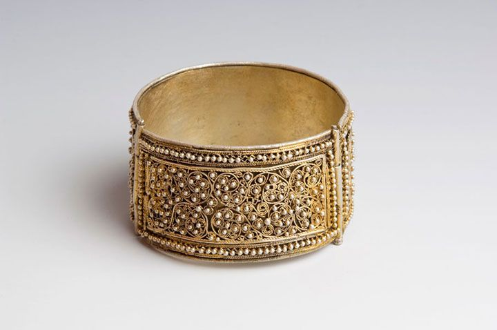 An ornate gilt silver cuff from Ethiopia, possibly made by Armenian jewelers.  Late 19th or early 20th century.  From the Museum of African Art