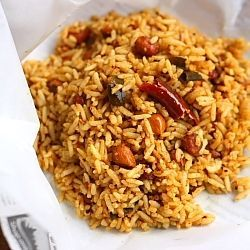 Tamarind rice flavored with roasted peanuts, sesame seeds and mild South Indian spices. This holds a special place in my heart!