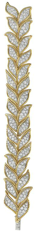 VAN CLEEF AND ARPELS.      An Important Diamond and Gold Bracelet.     Composed of a series of pavé-set diamond leaf shaped links, to the rope twist polished gold border, mounted in platinum and 18K yellow gold, length 7 inches. Signed 'VCA', no.NY31744, with a certificate of authenticity. Philips de Pury.