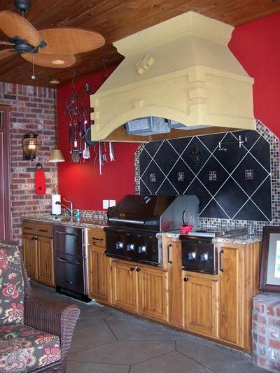 outdoor kitchen with red wall built in grill and custom ventilation hood outdoor kitchen on outdoor kitchen vent hood ideas id=43703