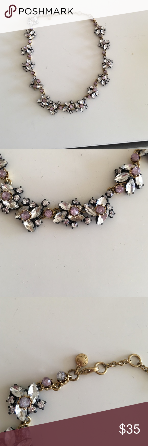 J crew necklace This j crew necklace has a gold chain with clear crystals and rounded amethyst stones. It dresses up y outfit. Great with scoop neck and crew neck shirts. J. Crew Jewelry Necklaces