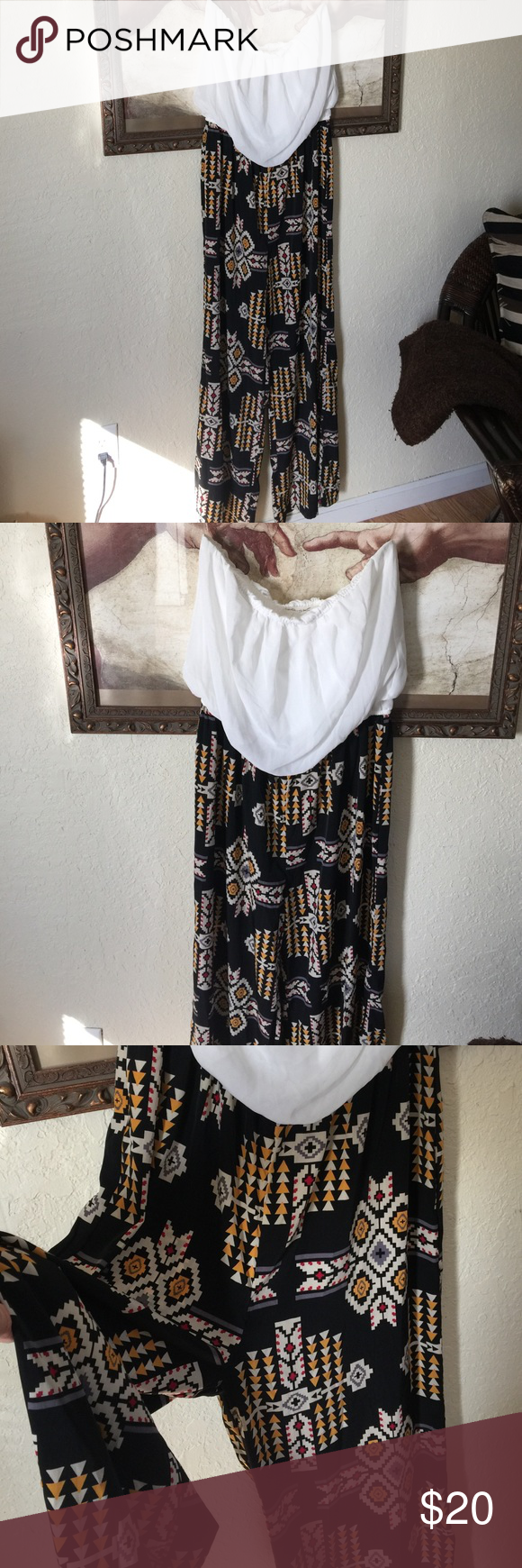 Flowing strapless jumpsuit NWOT stunning outfit. Bought for special occasion and never wore. Wrinkle free wide leg bottom. Elastic waist attached to lined white top. Make it yours with a beautiful large statement neck piece. Size L - 12/14 Liberty love Pants Jumpsuits & Rompers