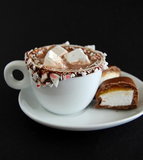 Chocolate Caramel Covered Marshmallows in hot chocolate rimmed with crushed peppermint candy canes.  Lucky Santa!