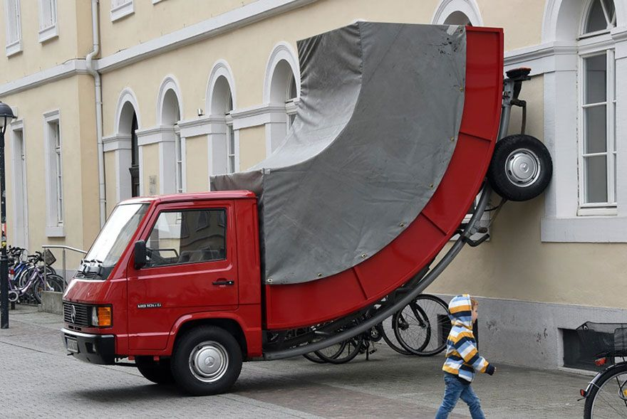 The German City Of Karlsruhe Just Issued A Parking Ticket To A Bent Car Sculpture By Austrian Artist Erwin Wurm