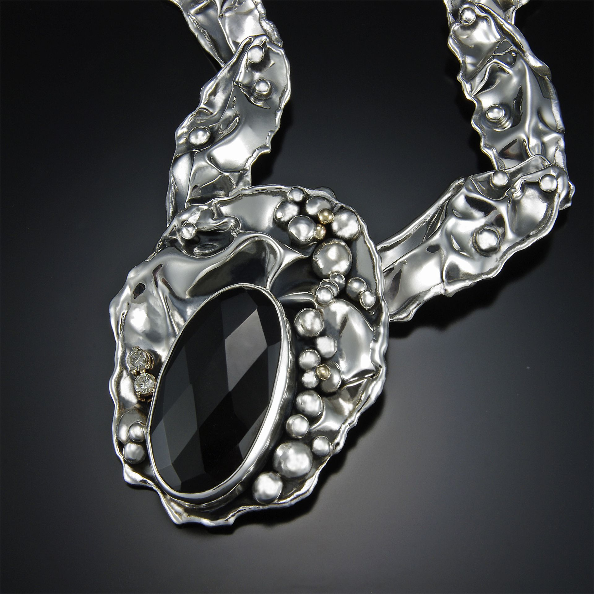 Midnight.   48ct Midnight Smoky Topaz in hand fabricated sterling silver necklace.