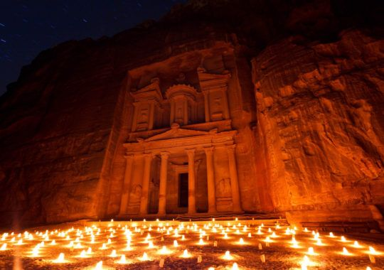 Travel to Jordan with Flash Pack and join like-minded solo travellers in their 30's & 40's. Admire Petra by night, surrounded by 1500 glowing candles & more #traveltojordan