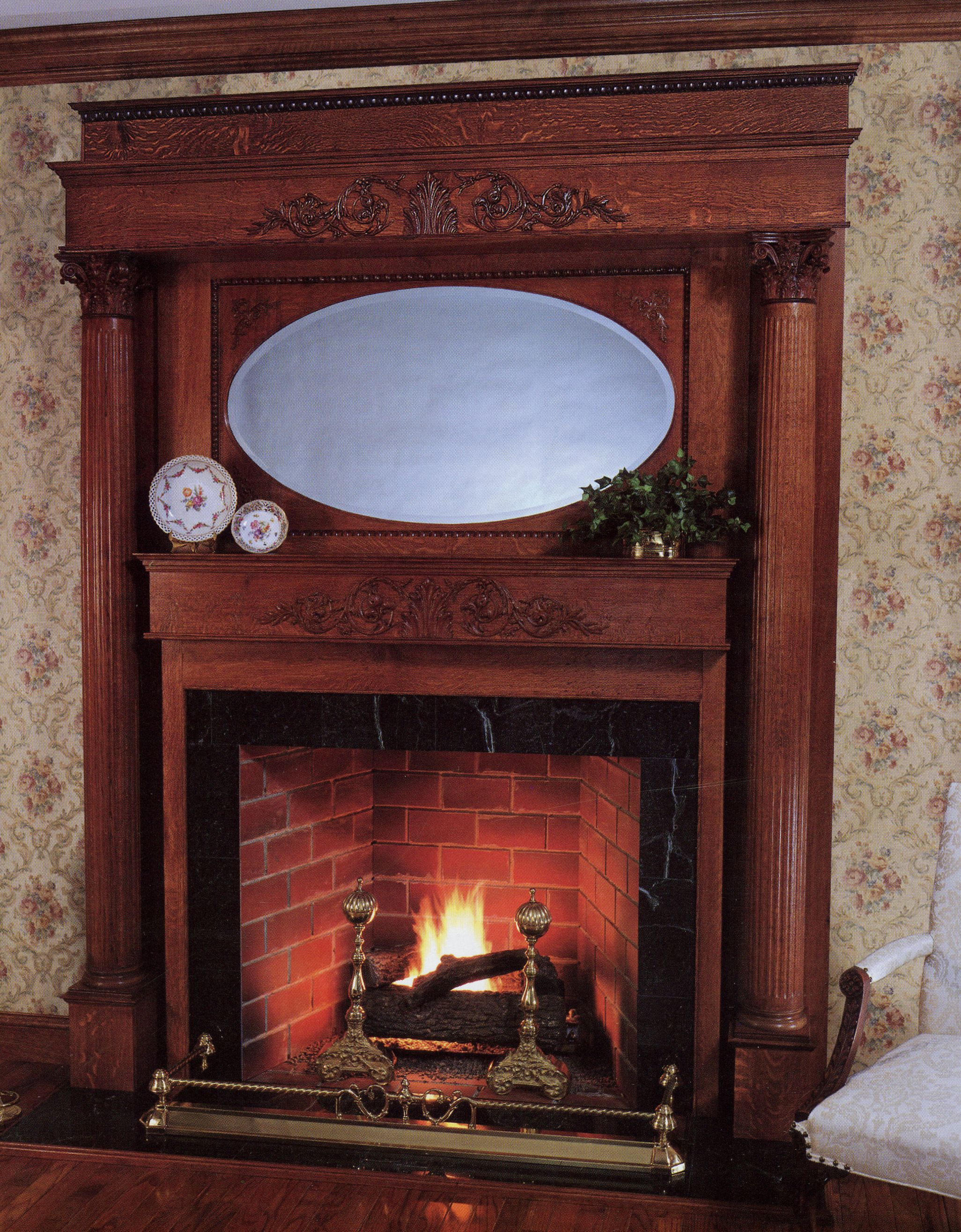 Inspiring Traditional Fireplace Mantel With Unique Wooden Panel And Great Oval Mirror And Beautiful White Floral Wallpaper And Antique Wooden Arm Chair Design For Rustic Home Interior Design