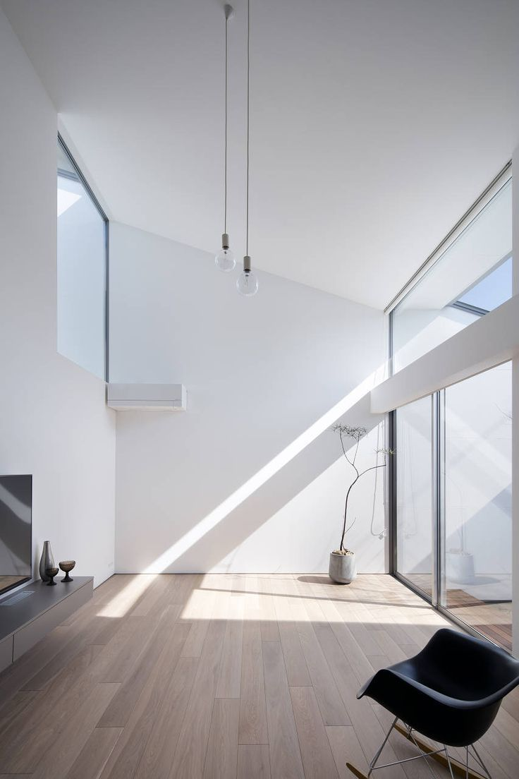 clean minimal bright interior. tall space with high windows to bring light in and feature pendant lighting. Minimalist   Modern Interiors   Modern Lighting   #minimalist