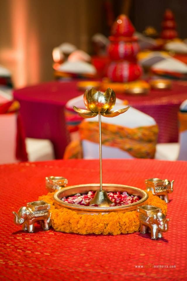 Mehndi centerpieces with brass lotus and elephants