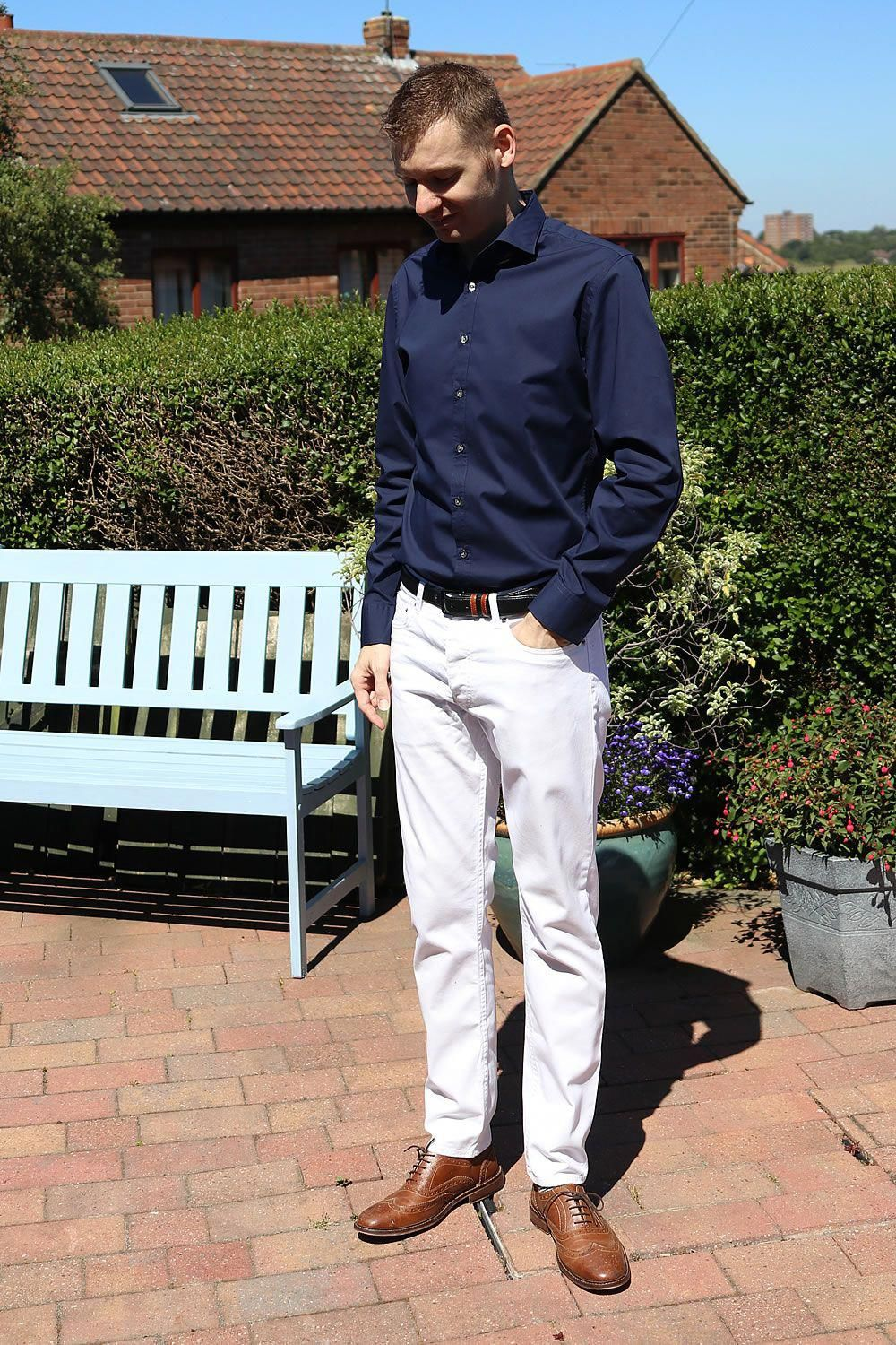 Wearing a navy shirt with white jeans