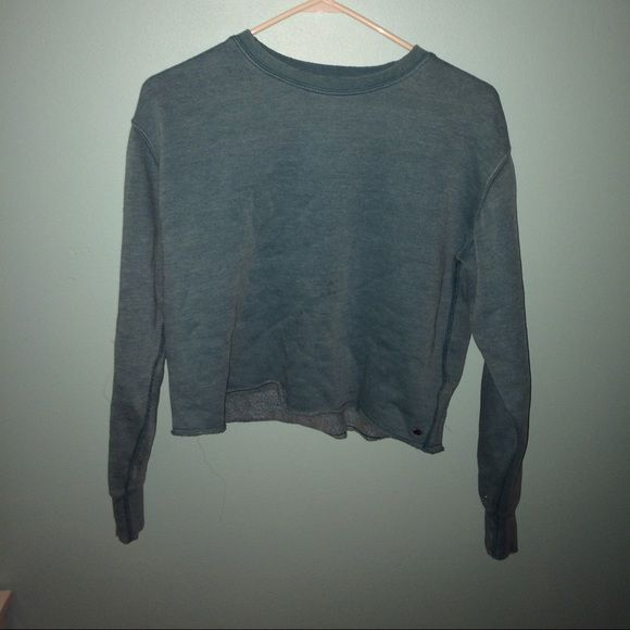 American eagle crop sweater Real crew neck American eagle long sleeve crop top with torn detail on collar and sleeves. Like new. American Eagle Outfitters Tops Tees - Long Sleeve