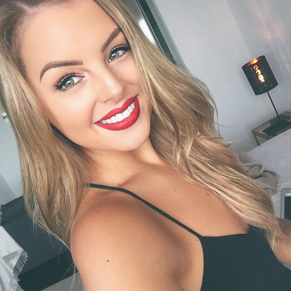 Gorgeous woman love her red lipstick u pearly white teeth  make