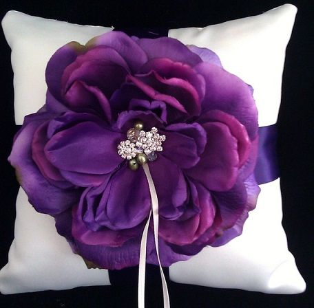 5 ways to color your wedding purple...love this pillow for the rings!