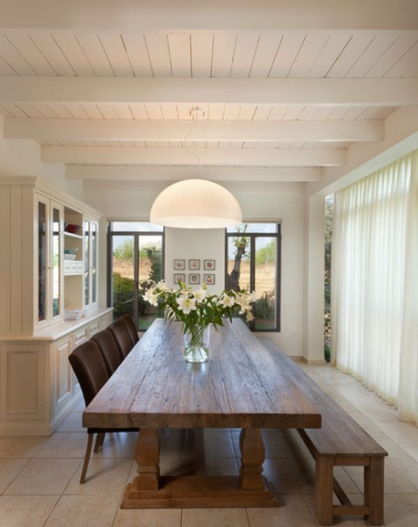 Bright Dining Room With A Long Wooden Table And A Matching Bench
