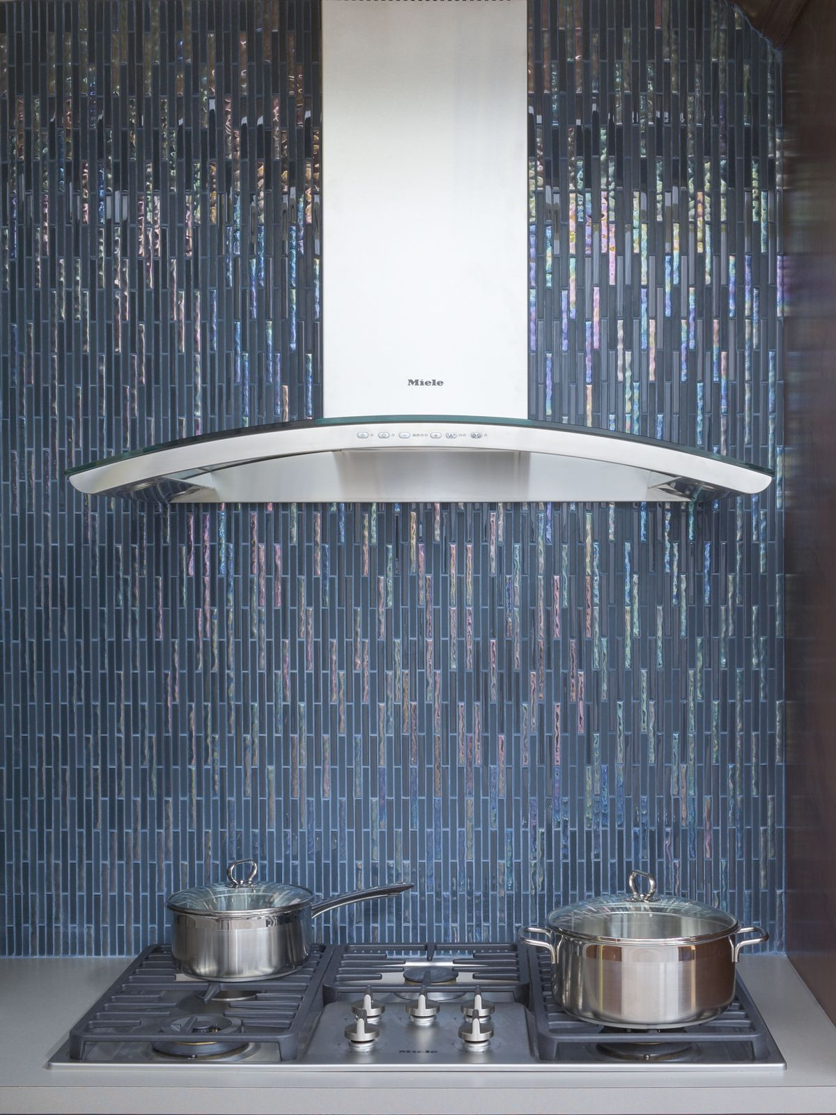 Interstyle Icestix glass mosaic tile looks like cascading water in this vertical orientation