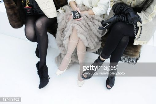 Spectators are photographed at ready-to-wear Fall/Winter 2010-2011 fashion week for Madame Figaro on April 2, 2010 in Paris, France. Published image. Figaro ID#: 096804-115.