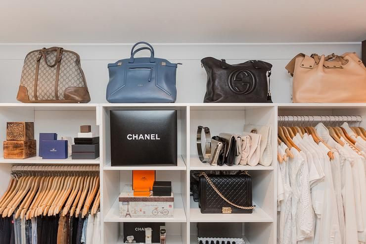 Glam Closet Features Designer Bags Placed On A Shelf Atop Clothing