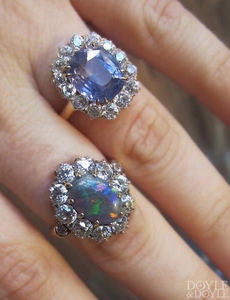 Beautiful pair of antique cocktail rings, sapphire and opal framed in diamonds. From Doyle & Doyle.