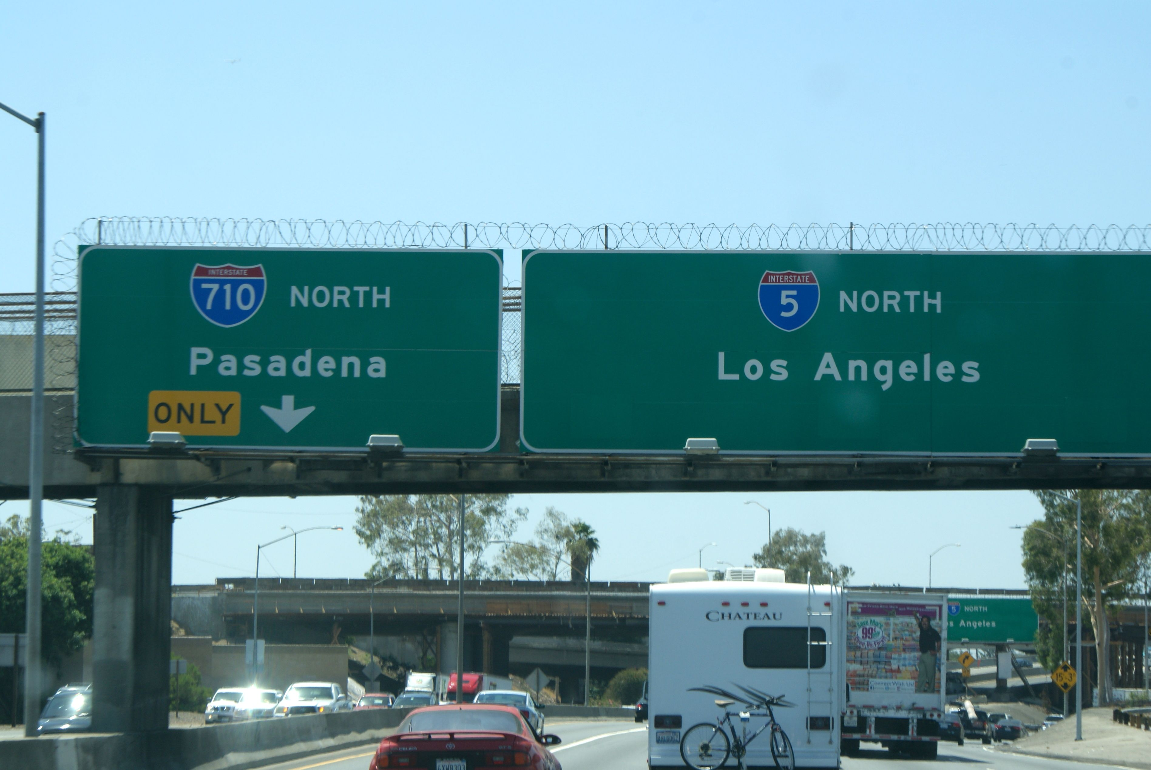 Freeway signs in Los Angeles. Razor wire to prevent graffiti ...
