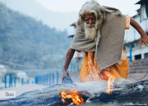 Sadhu by Zhushman Ganga India Rishikesh baba fire indian light old outdoor pilgrim piligrimage sadhu saint street tour
