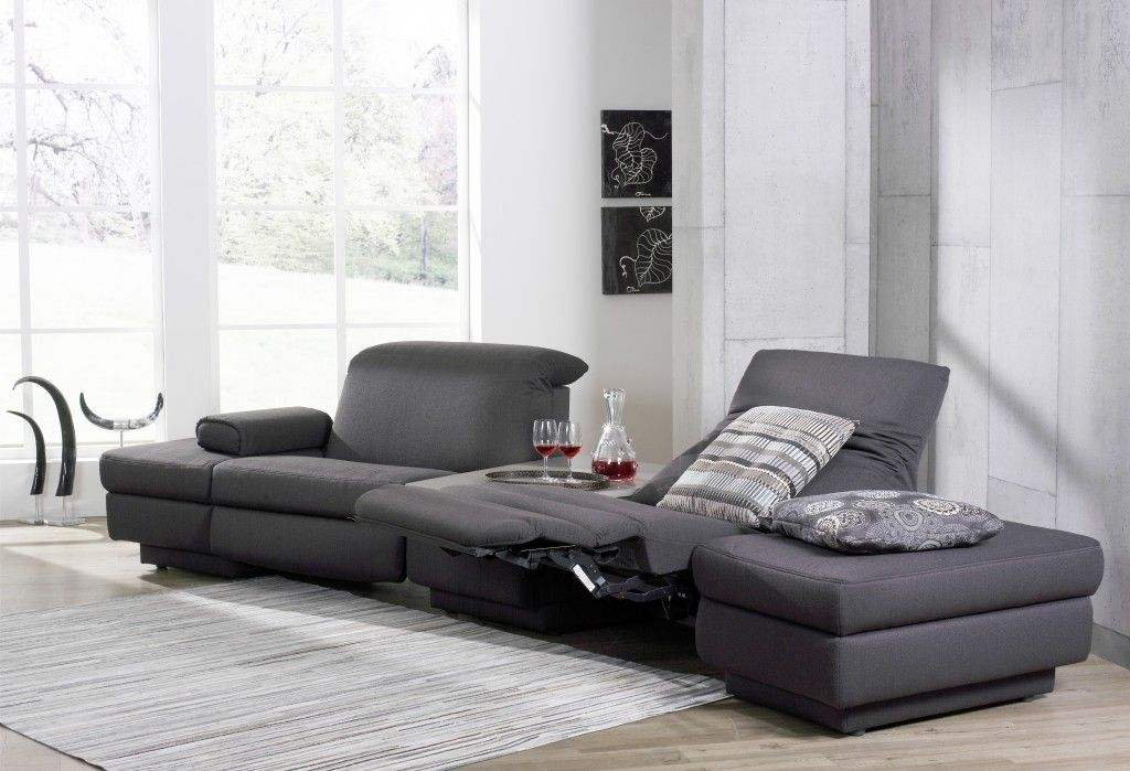 Sofa in Motion Himolla s sofas offer extended relaxation with integrated footrest and headrest