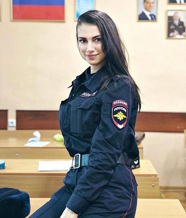 Russian girl police outfit curiously