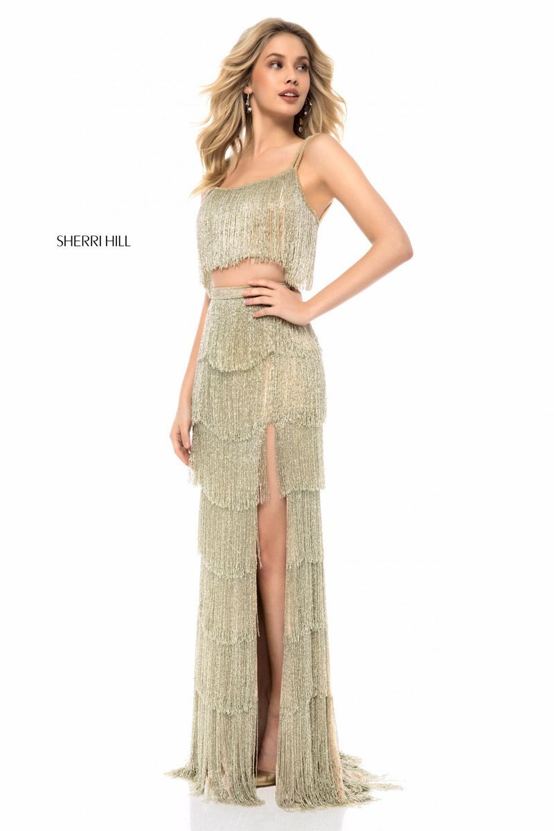 e131fef732f Sherri Hill 52081 is a tiered fringe two piece prom dress with a high skirt  slit.