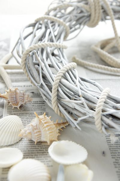 shells and white grapevine wreath with roping....