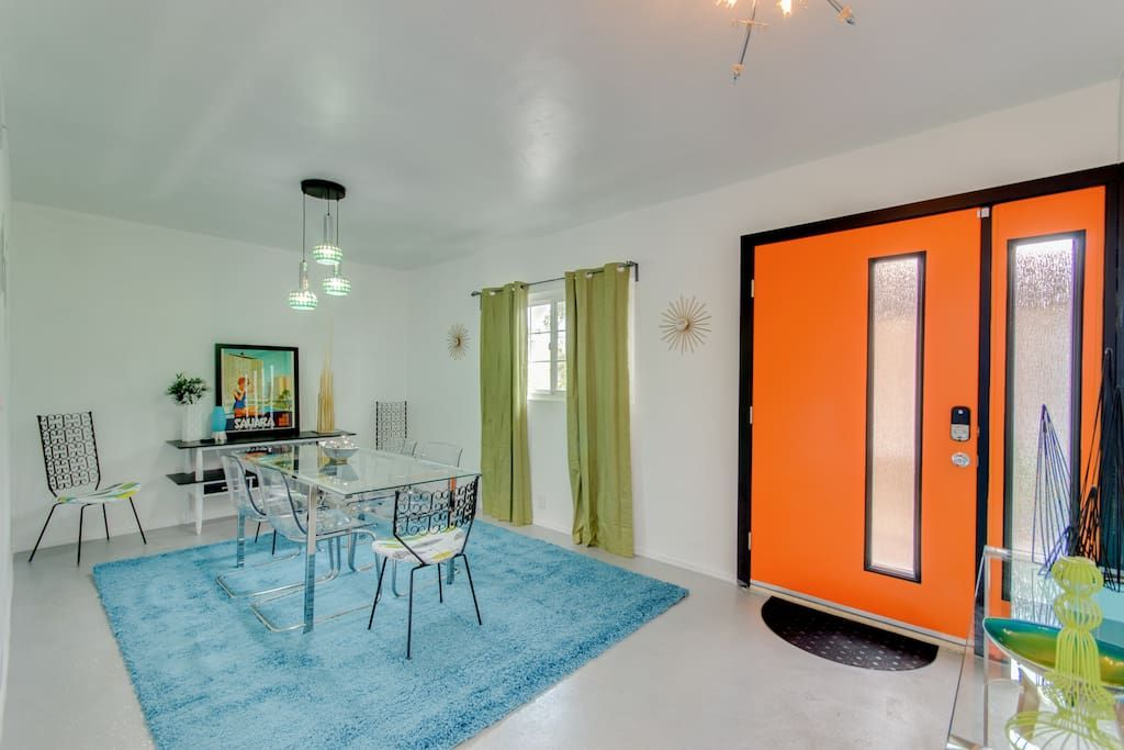 Tangerine front entry into a cool retro dining room. www.airbnb.com/rooms/14383804  #midcenturymodern