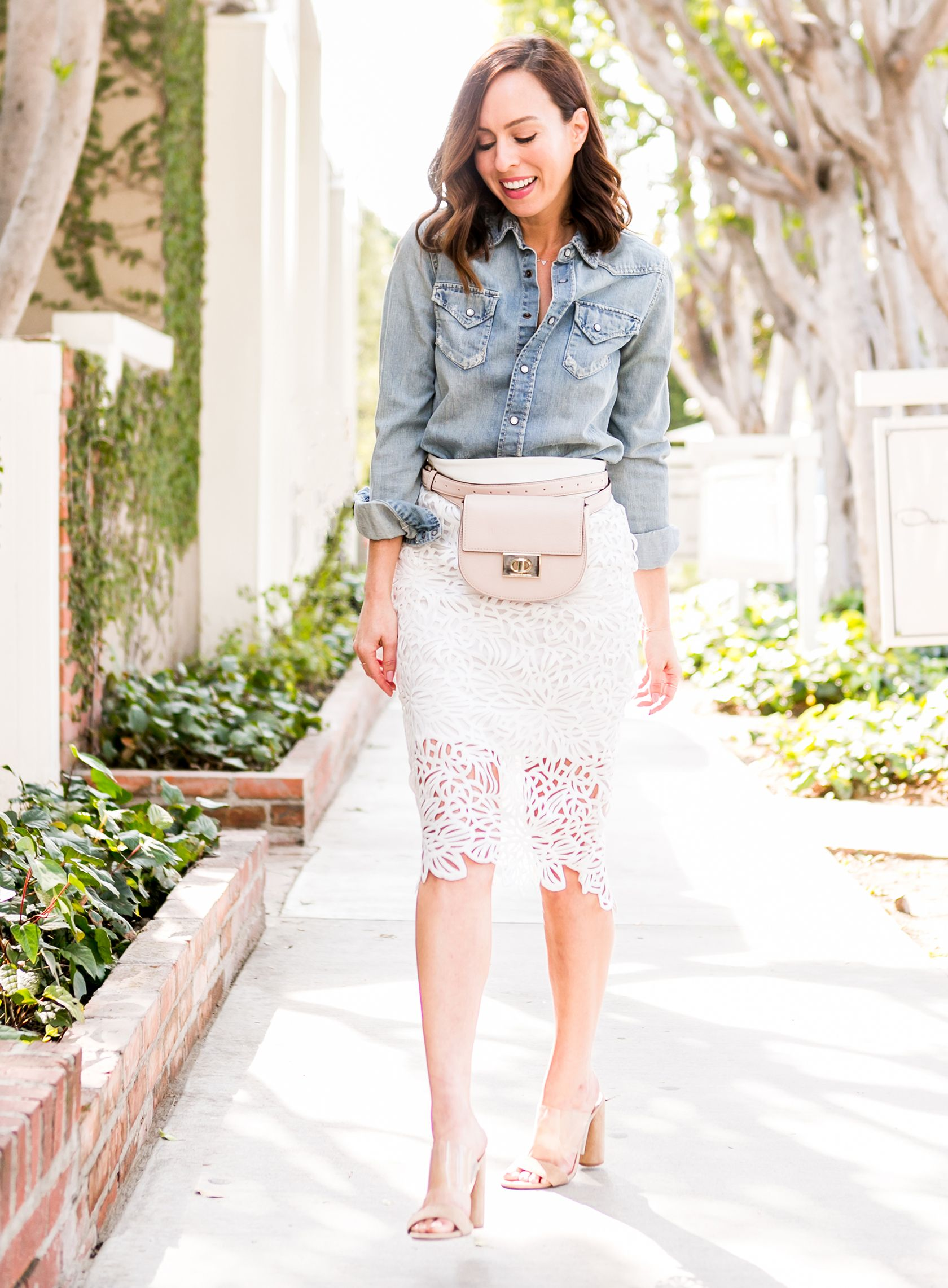 da2174415c65 Sydne Style shows what to wear with a denim skirt for spring outfit ideas   lace  springoutfits  white  chambray  beltbag