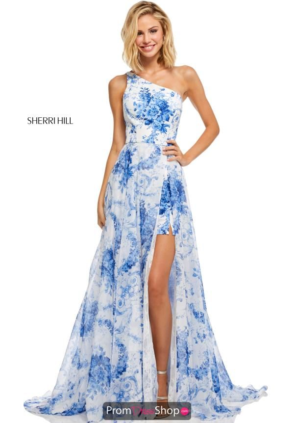3603d4433c The ivory blue combination on this Sherri Hill style 52728 is truly  spectacular. Featured is a flattering fitted bodice with a unique one  shoulder neckline.