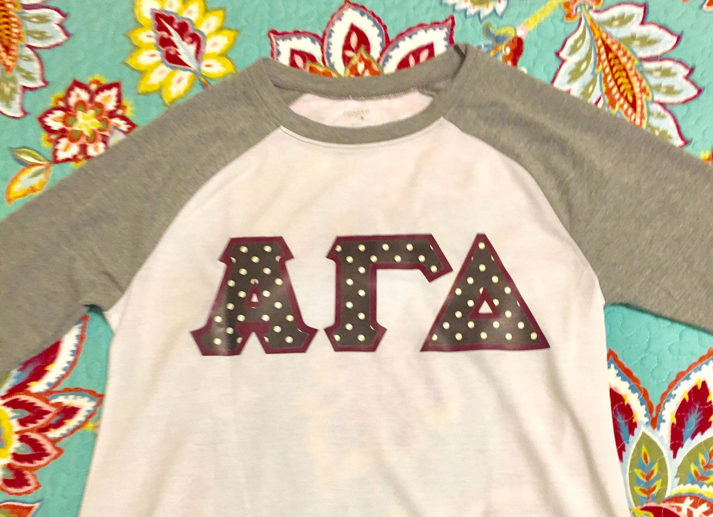 3d86e43ef196b Alpha Gamma Delta Raglan t-shirt with black and white polka dot and ...